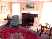 This Belmont home livingroom boasts hardwood floors and a fireplace
