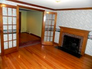There are hardwood floors in all of the bedrooms and both the family room and sitting room have their own fireplace
