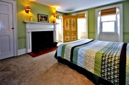 This Scituate house bedroom has a fireplace